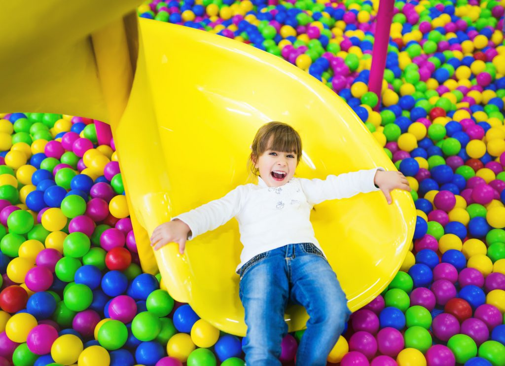 Happy child having fun in the playroom